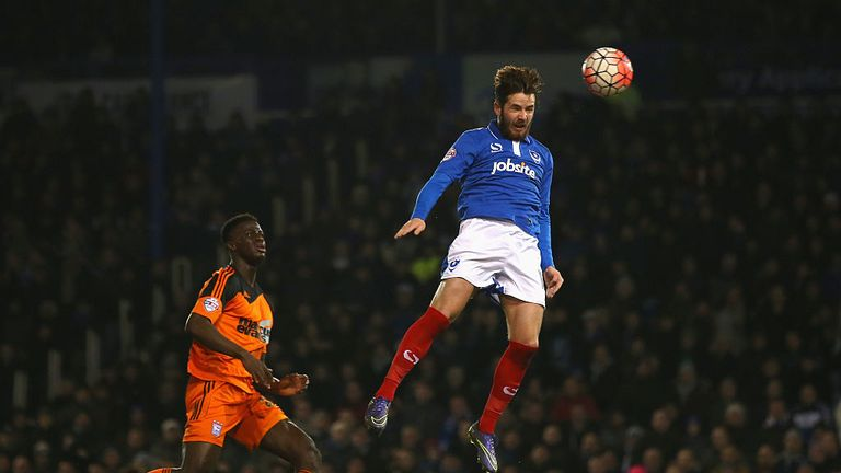 Portsmouth's Marc McNulty heads home his side's second goal against Ipswich