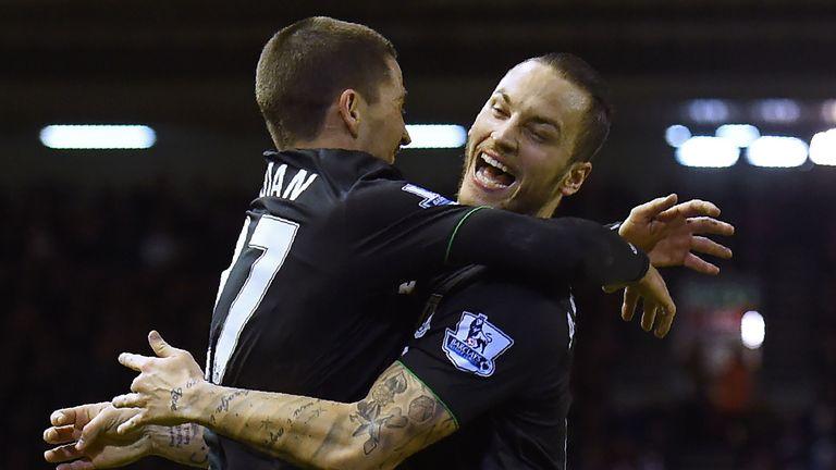 Stoke City's Marko Arnautovic (right) celebrates after scoring against Liverpool