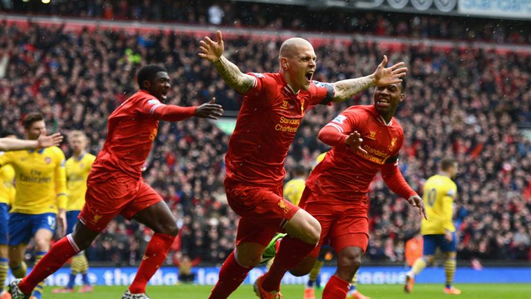 Martin Skrtel celebrates scoring against Arsenal in February 2014