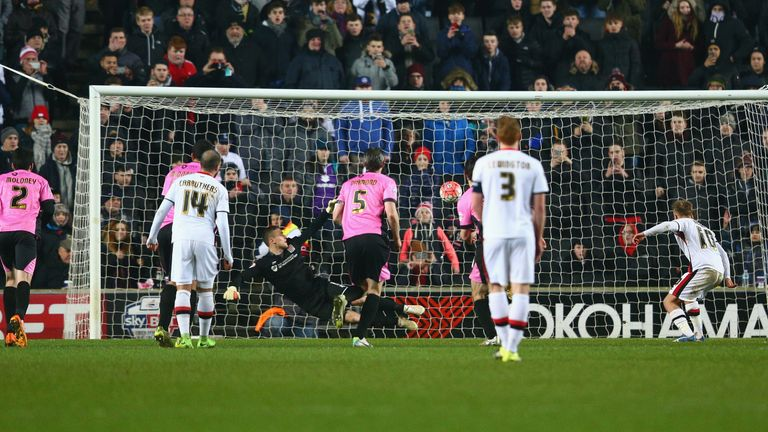 MK Dons' Ben Reeves scores from the penalty spot during FA Cup third round replay against Northampton
