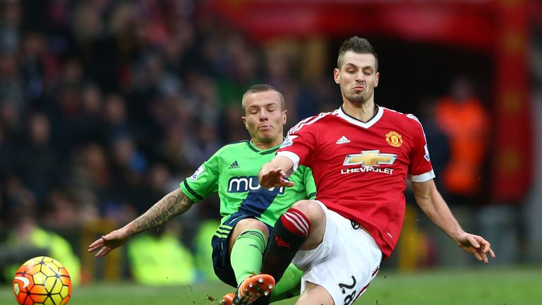 Morgan Schneiderlin (right) and Jordy Clasie crunch into a tackle