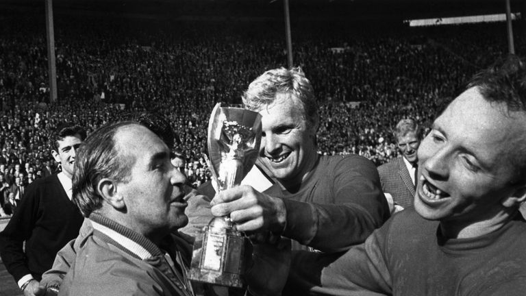 Sir Alf Ramsey is handed the Jules Rimet trophy after the 1966 final