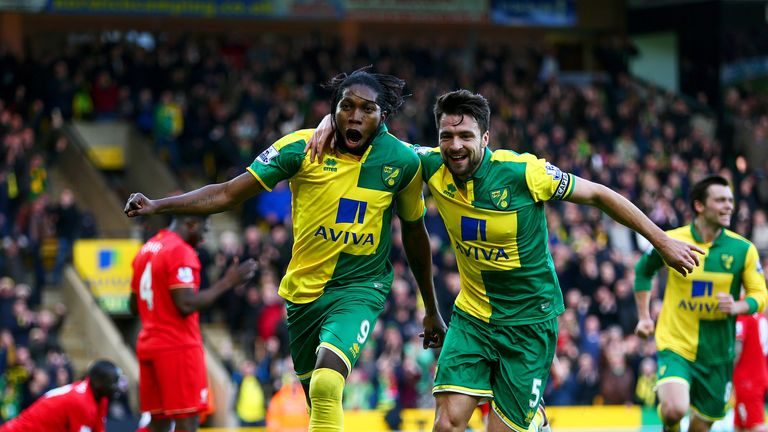 Dieumerci Mbokani celebrates after scoring from a corner