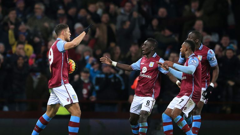 Rudy Gestede celebrates with his Aston Villa team-mates after scoring the equaliser against Leicester