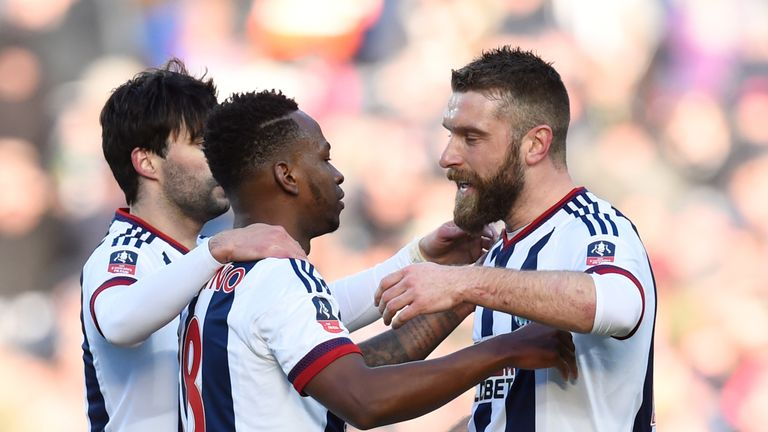Berahino (C) celebrates scoring West Brom's first goal against Peterborough with his team-mates Rickie Lambert (R) and Claudio Yacob (L)