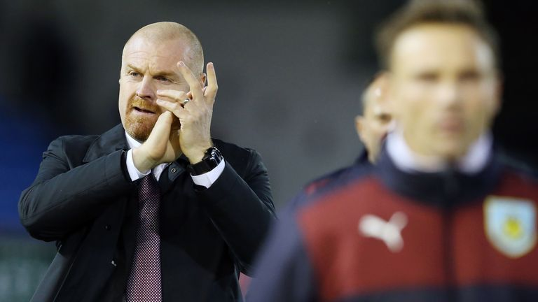 Sean Dyche applauds the Burnley fans after the match