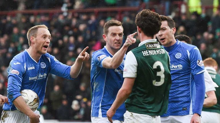 St Johnstone players take issue with Liam Henderson as he earns a penalty