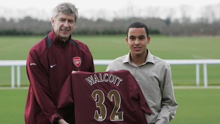 Theo Walcott - in hastily-bought shirt - poses with Arsene Wenger at his Arsenal unveiling in 2006