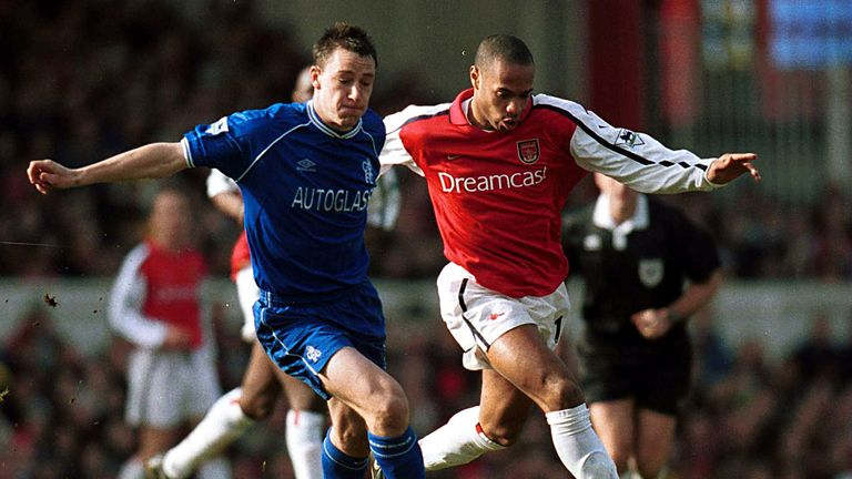 Terry holds off the challenge of Thierry Henry in 2001
