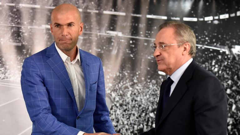 Zidane (left) is congratulated by Real Madrid's president Florentino Perez