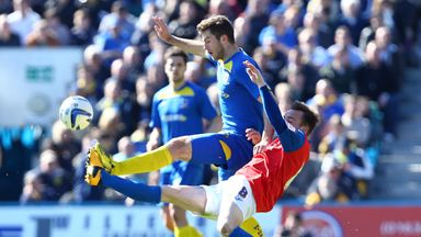 AFC Wimbledon secured a play-off spot with a 0-0 draw