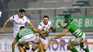 Ulster's Darren Cave looks to get past Treviso's Simone Ferrari and Tom Palmer