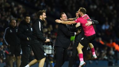Peterborough's Jon Taylor celebrates his late equaliser with manager Graham Westley