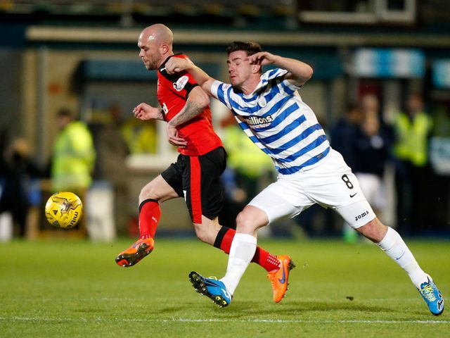 Nicky Law gets away from Ross Forbes