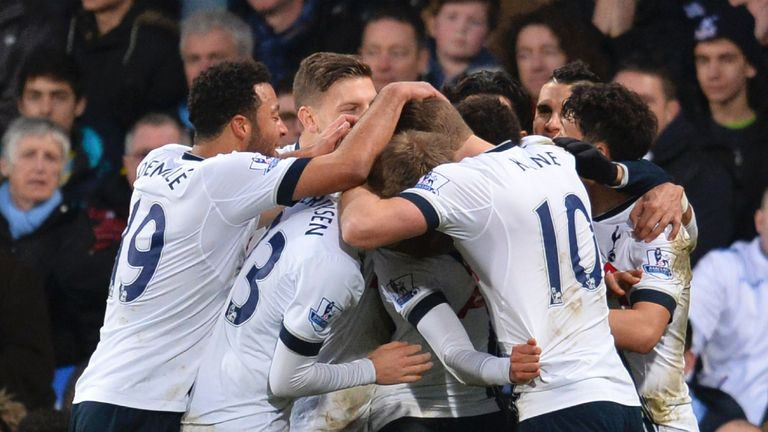 Tottenham Hotspur players celebrate after Dele Alli scored their second goal