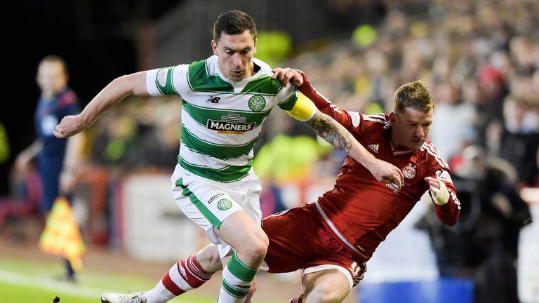 Celtic captain Scott Brown battles with Jonny Hayes