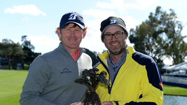 Brandt Snedeker and caddie Scott Vail pose with the winner's trophy