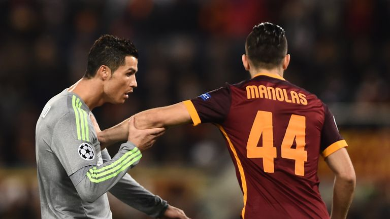 Ronaldo vies with Kostas Manolas during the first half at the Stadio Olimpico