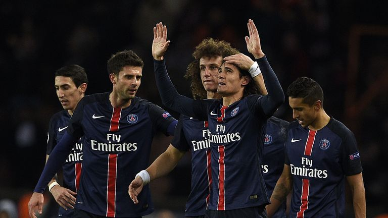 Paris Saint-Germain forward Edinson Cavani (C) celebrates with his team-mates after scoring the winning goal