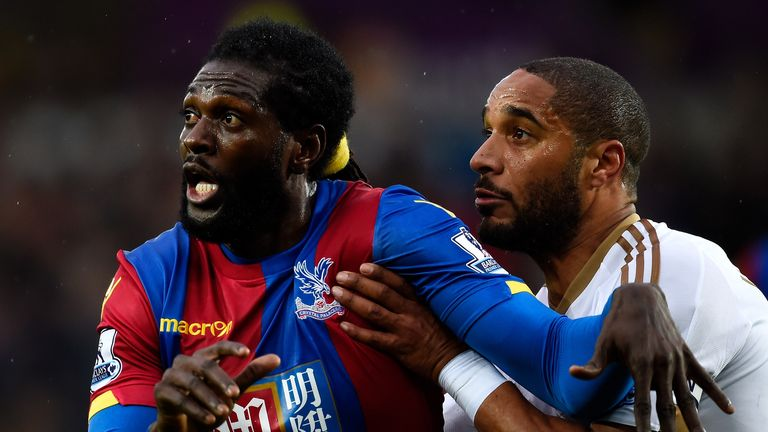 Emmanuel Adebayor and Ashley Williams (right) tangle