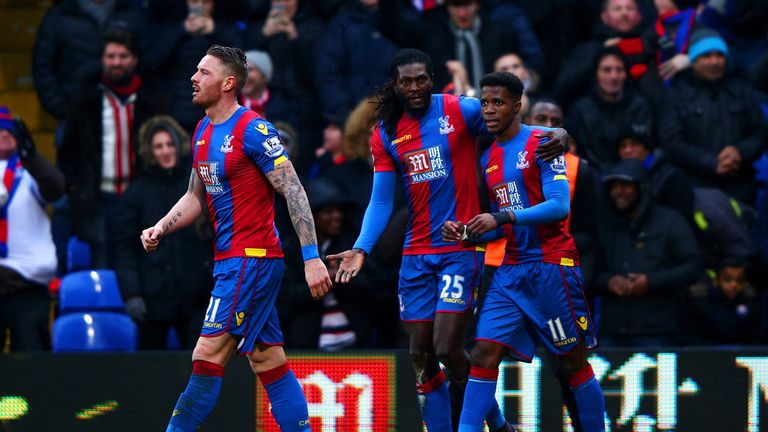 Emmanuel Adebayor is congratulated after equalising for Palace