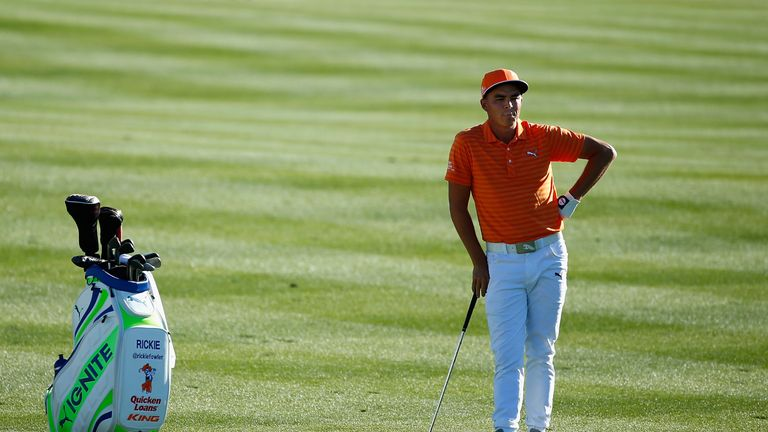 Crowd favourite Rickie Fowler had a two shot lead with two holes to play