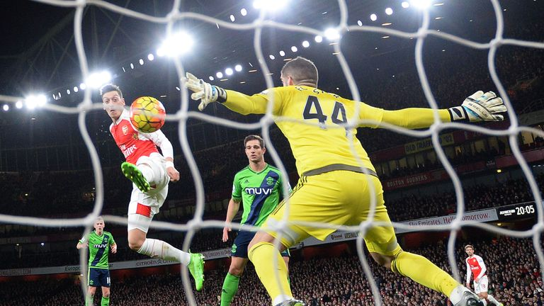 Fraser Forster denies Mesut Ozil in the first half with a point-blank save