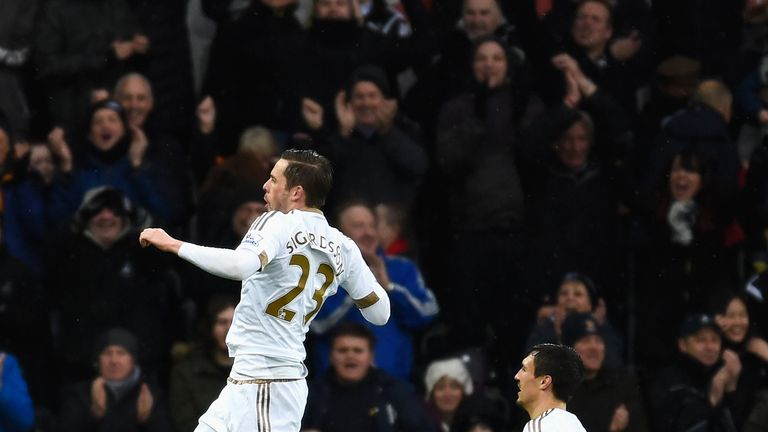 Sigurdsson (left) celebrates scoring his team's first goal