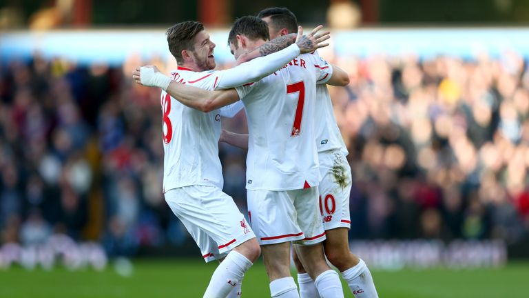 James Milner celebrates with team-mates after his cross found the bottom corner for the second goal