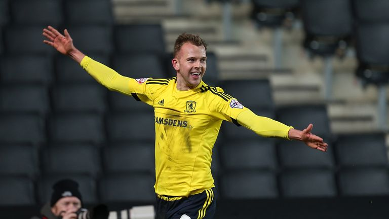 Jordan Rhodes celebrates after scoring Middlesbrough's equaliser and earning them a point against MK Dons