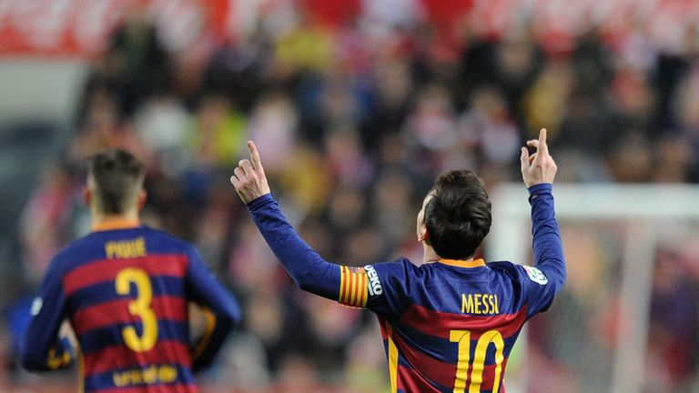 Messi celebrates after reaching the 300-goal landmark