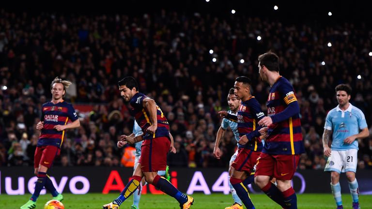 Luis Suarez scores his team's fourth goal after being assisted by Lionel Messi from the penalty spot