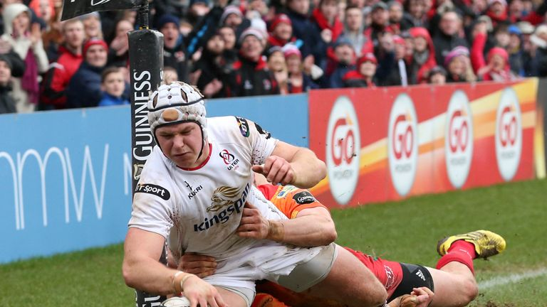 Ulster's Luke Marshall goes over for a try before being bundled into touch