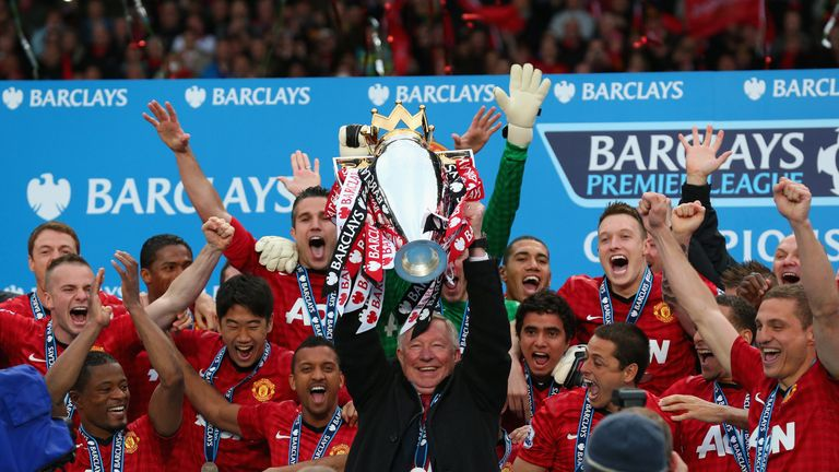 Former Manchester United boss Ferguson lifts the Premier League trophy