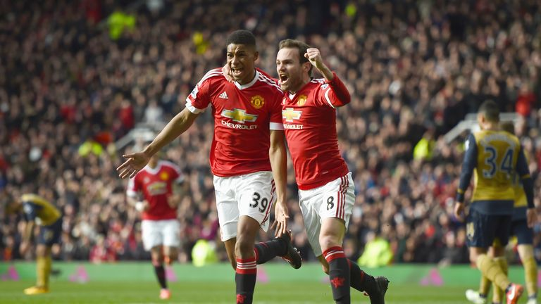 Rashford celebrates with Juan Mata after scoring for Manchester United