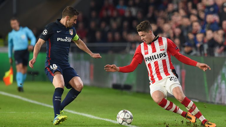 Atletico Madrid's midfielder Gabi (L) fights for the ball against PSV Eindhoven's midfielder Marco van Ginkel