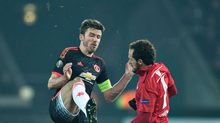 Manchester United's captain Michael Carrick (left) apologised to fans after their defeat to FC Midtjylland