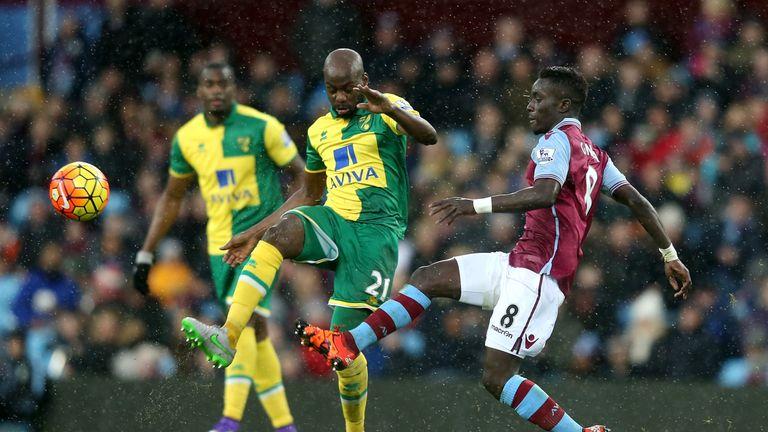 Youssouf Mulumbu of Norwich City and Idrissa Gueye of Aston Villa compete for the ball
