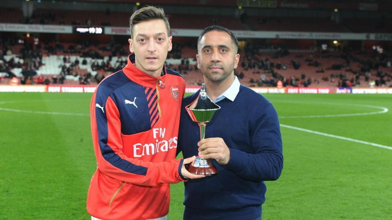 Mesut Ozil receives the PFA Fans' Player of the Month award for December