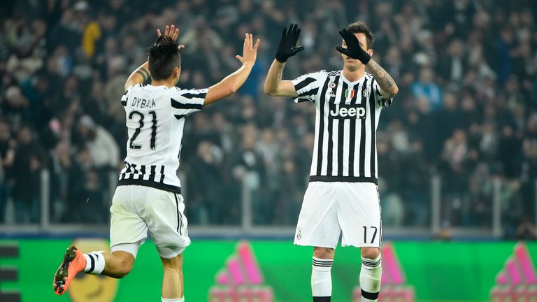 Paulo Dybala (L) celebrates with Mario Mandzukic after pulling a goal back for Juventus