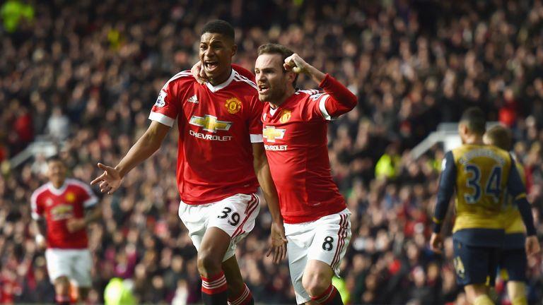 Marcus Rashford and Juan Mata celebrate during United's win over Arsenal