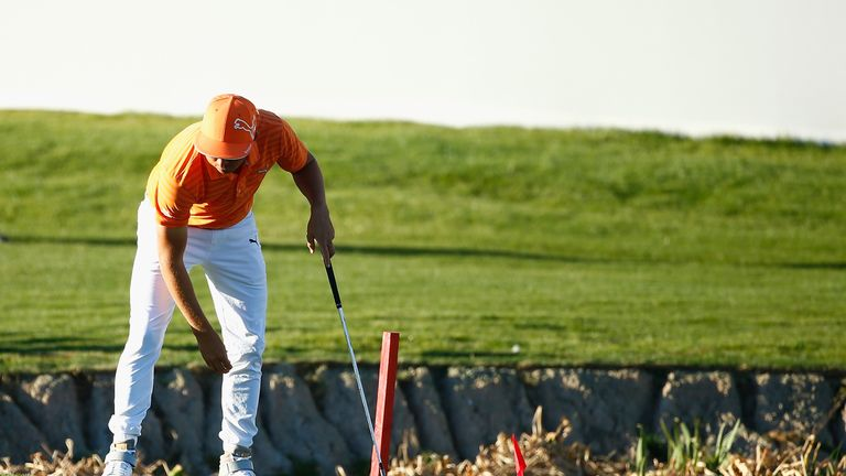 Rickie Fowler drove his ball in to the water on the fourth play-off hole in Phoenix, for the second time in an hour
