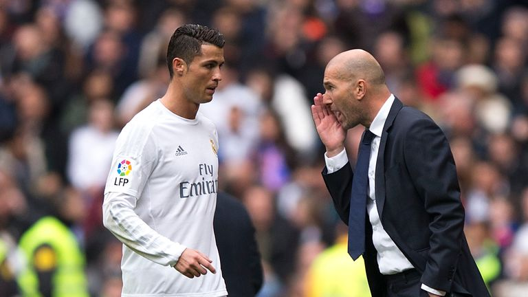Zinedine Zidane (right) gives instructions to Ronaldo
