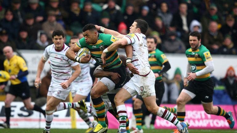 Saints centre Luther Burrell is tackled by Fergus Mulchrone