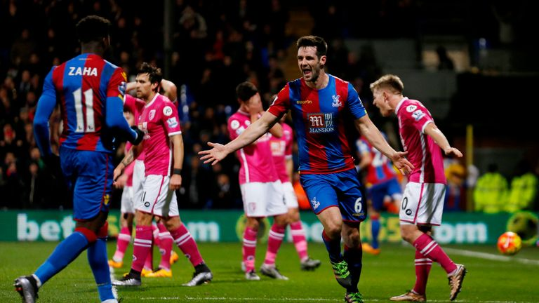 Scott Dann celebrates scoring the opening goal of the game for Crystal Palace.