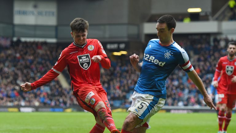 Calum Gallagher (left) battles for the ball against Lee Wallace