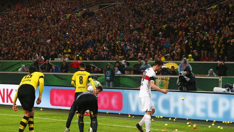 Borussia Dortmund fans protested ticket prices by throwing tennis balls onto the pitch