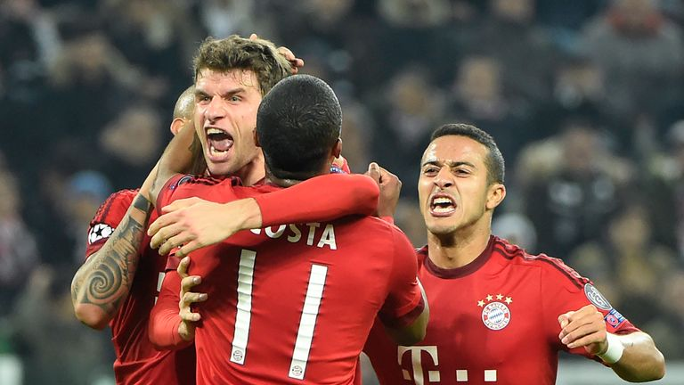 Thomas Muller (C) celebrates with teammates after scoring