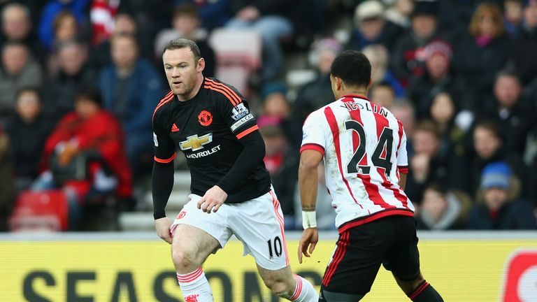 Wayne Rooney controls the ball under pressure of DeAndre Yedlin