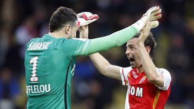 Monaco's Portuguese midfielder Silva Bernardo (R) celebrates with Monaco's Croatian goalkeeper Danijel Subasic